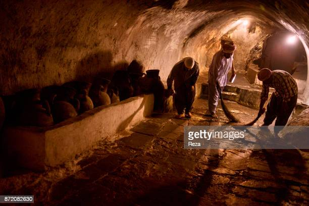 Lalish Nûranî Yazidi Temple Devotees sweep the floors of the chambers hewn out of solid rock at the Yazidi temple in Lalish The brooms are made of...