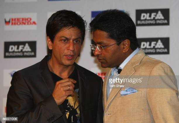 Lalit Modi the Chairman of the IPL and Shah Rukh Khan the owner of the Kolkata Knight Riders have a chat at a press conference at the CTICC on April...