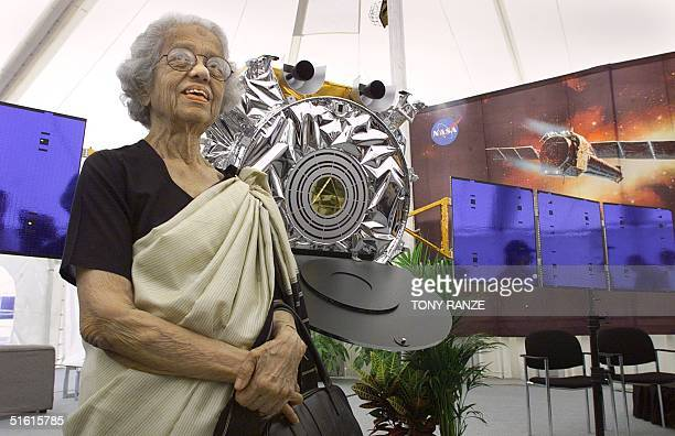 Lalitha Chandrasekhar of India stands beside a model of the Chandra X-ray Observatory named after her late husband, Nobel laureate Subrahmanyan...