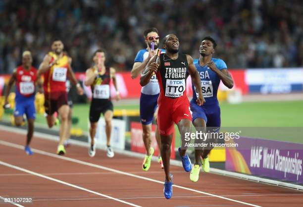 Lalonde Gordon of Trinidad and Tobago crosses the finish line ahead of Fred Kerley of the United States in the Men's 4x400 Metres Relay final during...