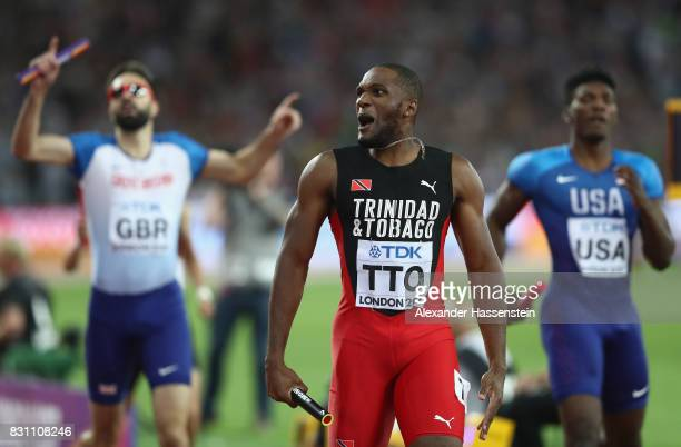 Lalonde Gordon of Trinidad and Tobago reacts after crossing the finish line ahead of Fred Kerley of the United States and Martyn Rooney of Great...
