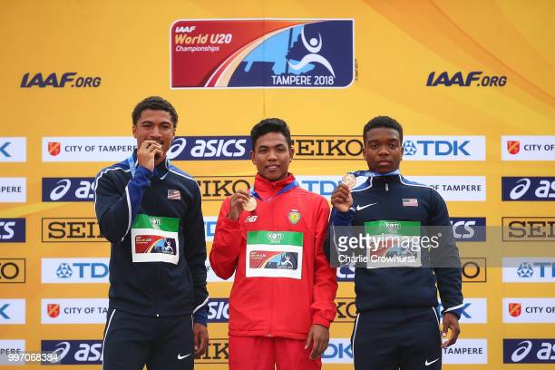 Lalu Muhammed Zohri of Indonesia Anthony Scwartz of The USA and Eric Harrison of The USA pose for a picture with their medals during the medal...