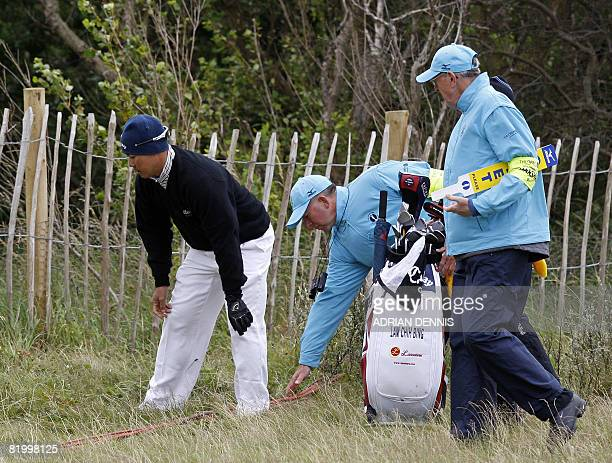 Lam Chih Bing of Singapore looks for his ball on the 1st in the third round at The Open golf tournament at Royal Birkdale in Southport in northwest...