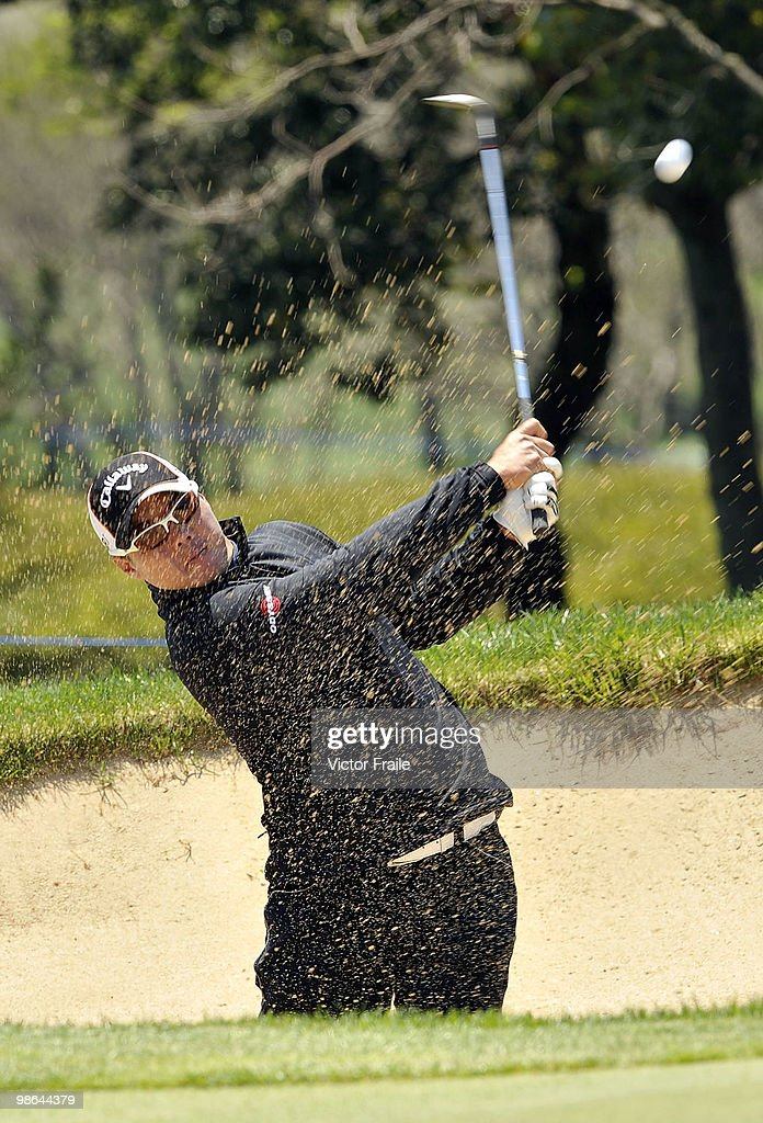 Lam Chih-bing of Singapore plays a bunker shot on the 12th hole during the Round Two of the Ballantine's Championship at Pinx Golf Club on April 24, 2010 in Jeju island, South Korea.