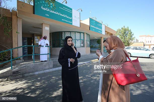 Lama AlSalman arrives with a friend at a polling station for the municipal elections on December 12 2015 in Jeddah Saudi Arabia Lama AlSalman won a...