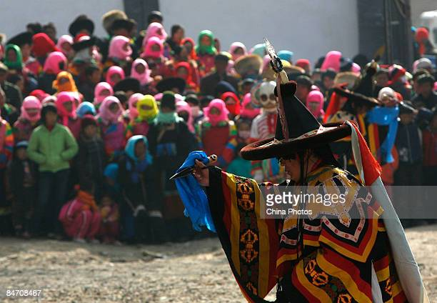 A lama dances during the 'Tiaoqian' praying ceremony at the Youning Temple on February 8 2009 in Huzhu County of Qinghai Province China The Youning...