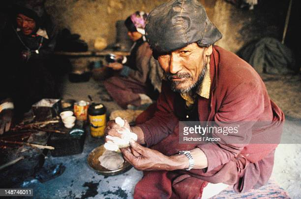 Lama making ceremonial cakes in preparation for  private ceremony in village of Halsi.