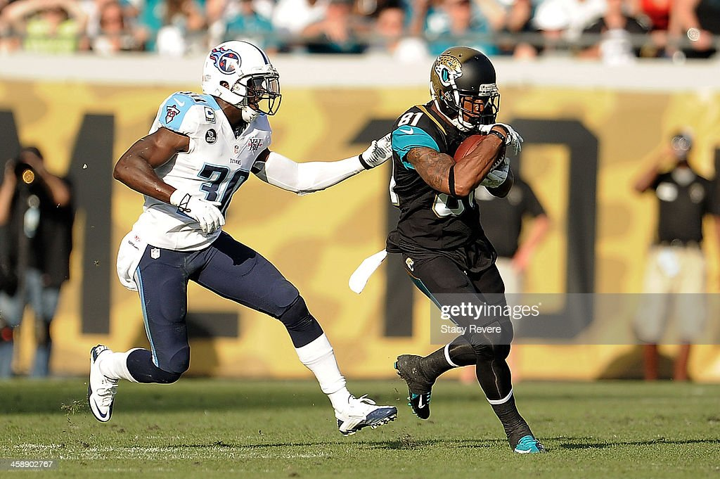 Lamaar Thomas #81 of the Jacksonville Jaguars catches a pass in front of Jason McCourty #30 of the Tennessee Titans during a game at EverBank Field on December 22, 2013 in Jacksonville, Florida. Tennessee won the game 20-16.