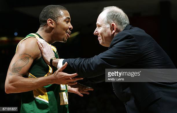 Lamar Butler of the George Mason Patriots celebrates with Coach Jim Larranaga during the game against the North Carolina Tar Heels in the Second...