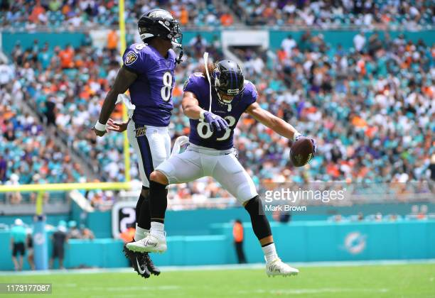 Lamar Jackson and Willie Snead of the Baltimore Ravens celebrate a touchdown in the second quarter against the Miami Dolphins at Hard Rock Stadium on...