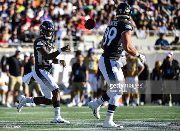Lamar Jackson looks to pass to Mark Andrews of the Baltimore Ravens during the 2020 NFL Pro Bowl at Camping World Stadium on January 26 2020 in...