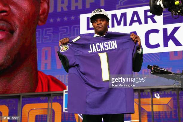 Lamar Jackson of Louisville poses after being picked overall by the Baltimore Ravens during the first round of the 2018 NFL Draft at ATT Stadium on...