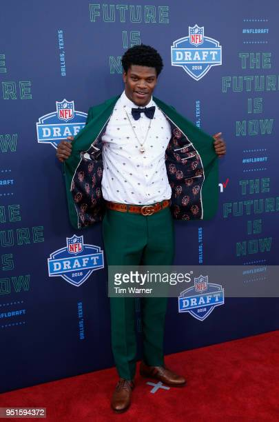 Lamar Jackson of Louisville poses on the red carpet prior to the start of the 2018 NFL Draft at ATT Stadium on April 26 2018 in Arlington Texas