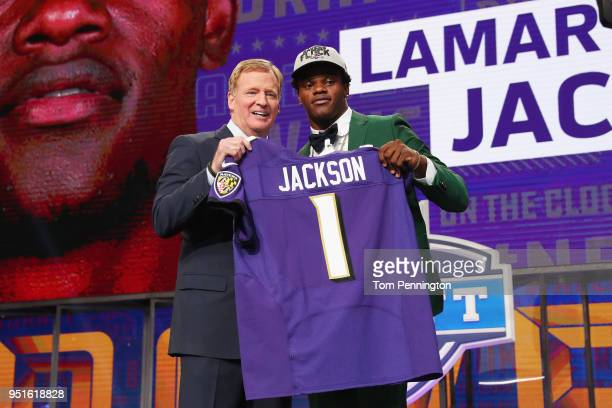 Lamar Jackson of Louisville poses with NFL Commissioner Roger Goodell after being picked overall by the Baltimore Ravens during the first round of...