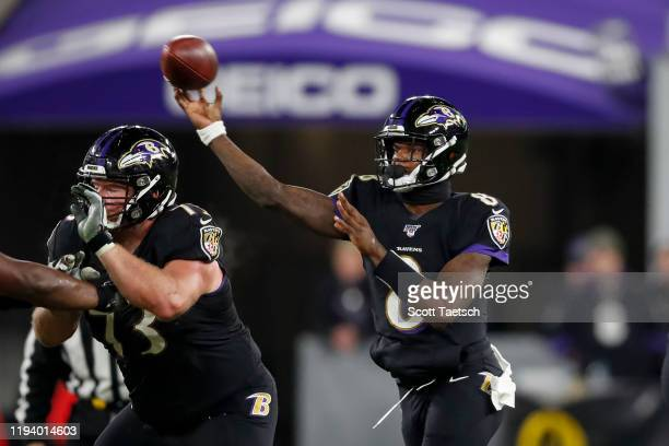 Lamar Jackson of the Baltimore Ravens attempts a pass against the New York Jets during the second half at MT Bank Stadium on December 12 2019 in...
