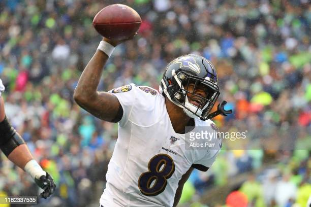 Lamar Jackson of the Baltimore Ravens celebrates after scoring an eight yard touchdown against the Seattle Seahawks in the third quarter during their...