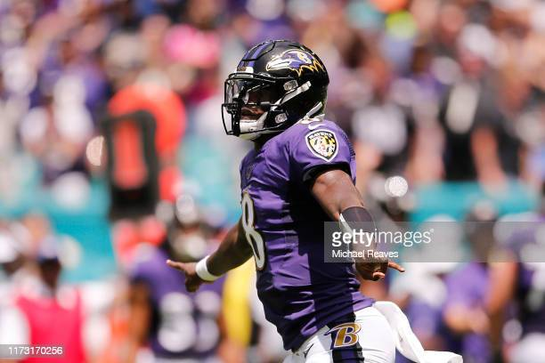 Lamar Jackson of the Baltimore Ravens celebrates after throwing a 47yard touchdown to Marquise Brown during the first quarter against the Miami...