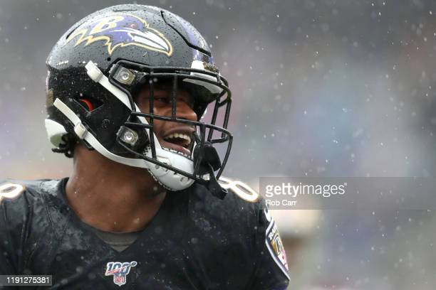 Lamar Jackson of the Baltimore Ravens celebrates against the San Francisco 49ers after throwing a first quarter touchdown pass at MT Bank Stadium on...