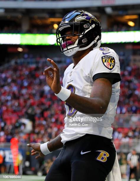 Lamar Jackson of the Baltimore Ravens celebrates rushing for a touchdown against the Atlanta Falcons at MercedesBenz Stadium on December 2 2018 in...