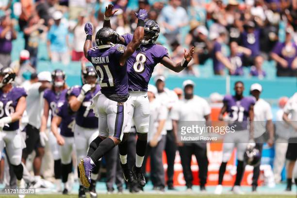 Lamar Jackson of the Baltimore Ravens celebrates with Mark Ingram after a touchdown against the Miami Dolphins during the second quarter at Hard Rock...