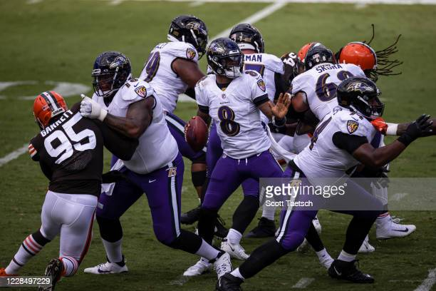 Lamar Jackson of the Baltimore Ravens drops back to pass against the Cleveland Browns during the first half at M&T Bank Stadium on September 13, 2020...