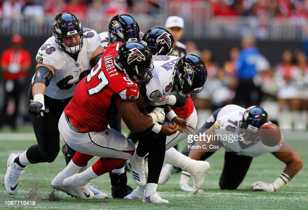 Lamar Jackson of the Baltimore Ravens fumbles the ball as he is tackled by Grady Jarrett of the Atlanta Falcons at MercedesBenz Stadium on December 2...