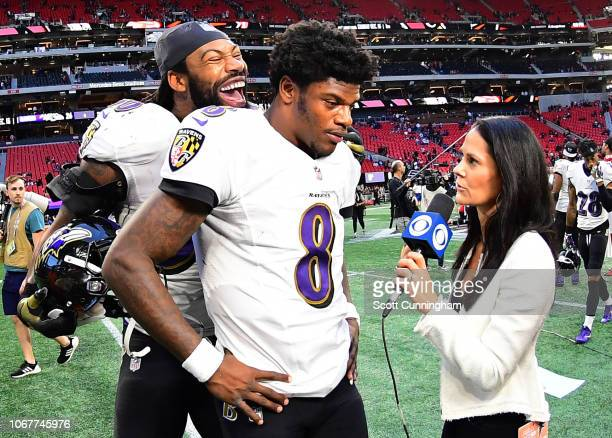 Lamar Jackson of the Baltimore Ravens is interviewed after the game against the Atlanta Falcons by Tracy Wolfson as ZaDarius Smith joins in at...