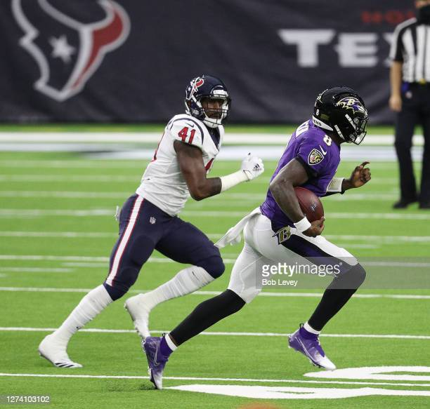 Lamar Jackson of the Baltimore Ravens is tackled by Zach Cunningham of the Houston Texans at NRG Stadium on September 20, 2020 in Houston, Texas.