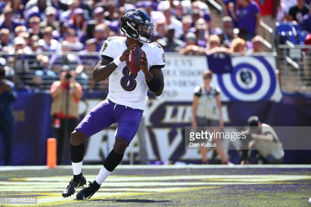 Lamar Jackson of the Baltimore Ravens looks to pass against Arizona Cardinals during the first half at MT Bank Stadium on September 15 2019 in...