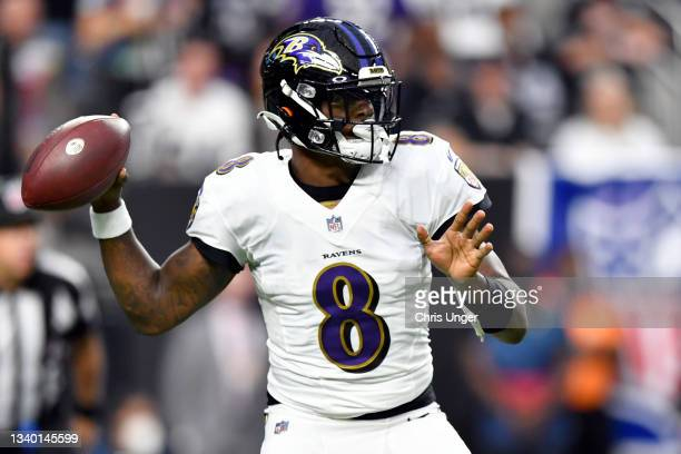 Lamar Jackson of the Baltimore Ravens looks to pass against the Las Vegas Raiders during the first quarter at Allegiant Stadium on September 13, 2021...