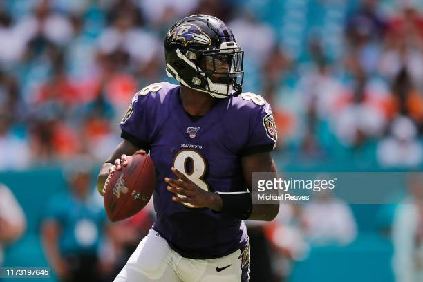Lamar Jackson of the Baltimore Ravens looks to pass against the Miami Dolphins during the third quarter at Hard Rock Stadium on September 08 2019 in...