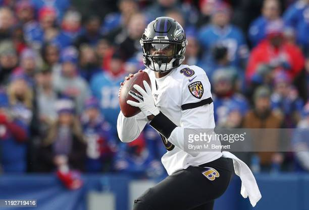 Lamar Jackson of the Baltimore Ravens looks to pass during the first half against the Buffalo Bills in the game at New Era Field on December 08 2019...