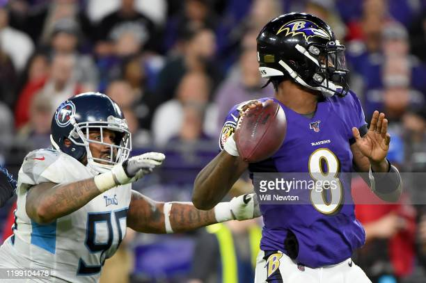 Lamar Jackson of the Baltimore Ravens looks to pass in front of Jurrell Casey of the Tennessee Titans during the AFC Divisional Playoff game at M&T...