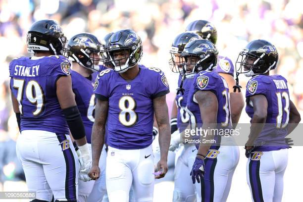 Lamar Jackson of the Baltimore Ravens reacts after a play against the Los Angeles Chargers during the second quarter in the AFC Wild Card Playoff...