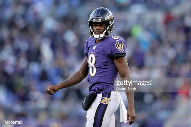 Lamar Jackson of the Baltimore Ravens reacts after a play against the Los Angeles Chargers during the fourth quarter in the AFC Wild Card Playoff...