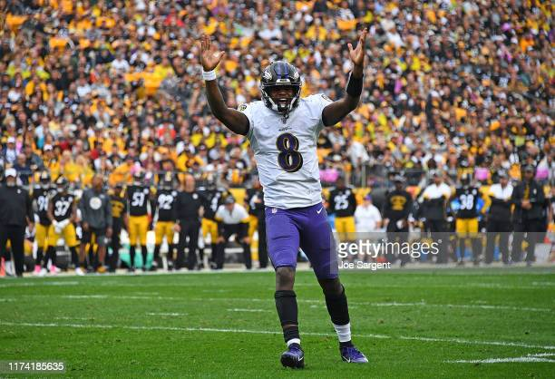Lamar Jackson of the Baltimore Ravens reacts after a touchdown by Mark Ingram during the first quarter against the Pittsburgh Steelers at Heinz Field...