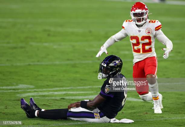 Lamar Jackson of the Baltimore Ravens reacts after being knocked down in front of Juan Thornhill of the Kansas City Chiefs at M&T Bank Stadium on...