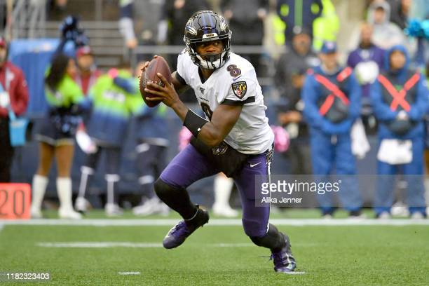 Lamar Jackson of the Baltimore Ravens rolls out of the pocket during the first half of the game against the Seattle Seahawks at CenturyLink Field on...
