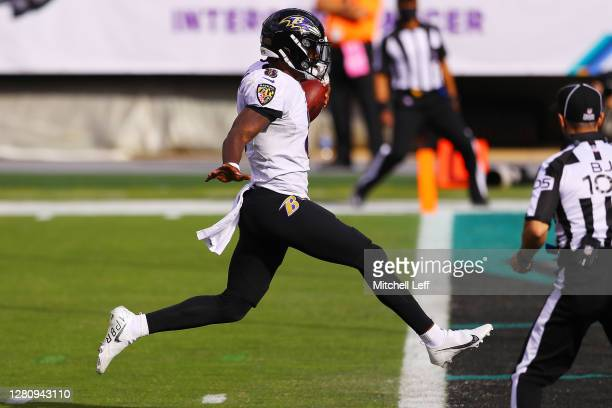Lamar Jackson of the Baltimore Ravens runs for a touchdown against the Philadelphia Eagles during the third quarter at Lincoln Financial Field on...