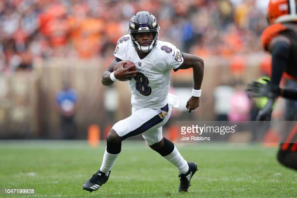 Lamar Jackson of the Baltimore Ravens runs the ball in the third quarter against the Cleveland Browns at FirstEnergy Stadium on October 7 2018 in...