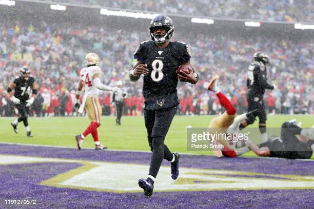 Lamar Jackson of the Baltimore Ravens rushes for a 1yard touchdown during the second quarter against the San Francisco 49ers at MT Bank Stadium on...
