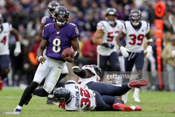 Lamar Jackson of the Baltimore Ravens rushes for a first down in the third quarter against the Houston Texans at MT Bank Stadium on November 17 2019...