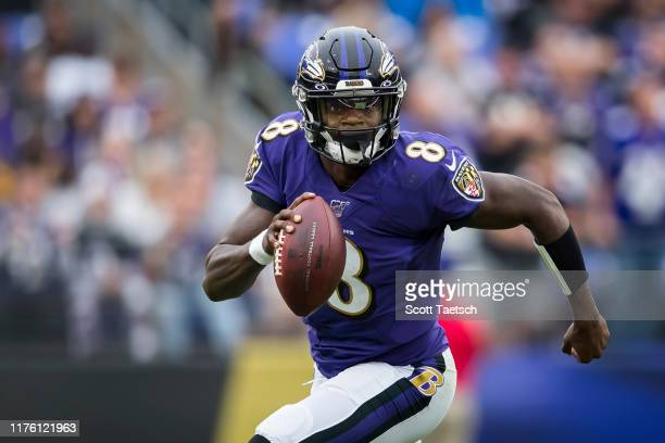 Lamar Jackson of the Baltimore Ravens scrambles against the Cincinnati Bengals during the second half at MT Bank Stadium on October 13 2019 in...