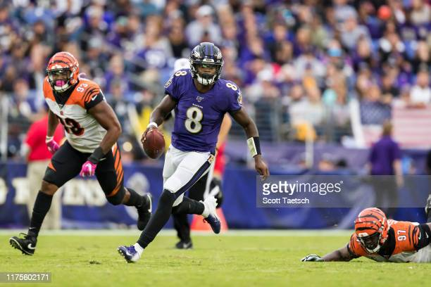 Lamar Jackson of the Baltimore Ravens scrambles during the second half against the Cincinnati Bengals at MT Bank Stadium on October 13 2019 in...
