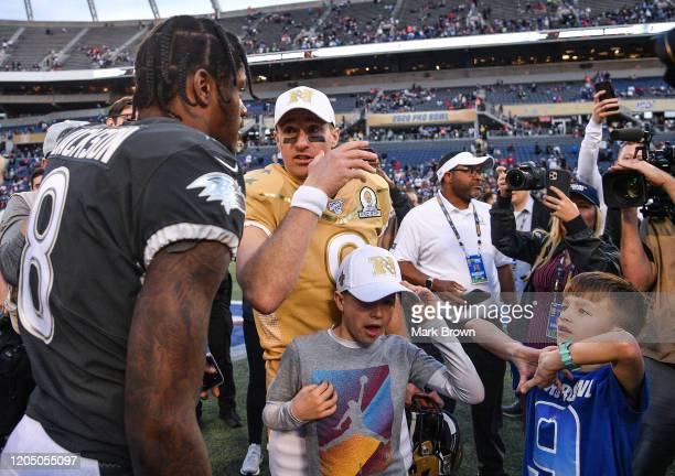 Lamar Jackson of the Baltimore Ravens speaks with Drew Brees of the New Orleans Saints after the 2020 NFL Pro Bowl at Camping World Stadium on...