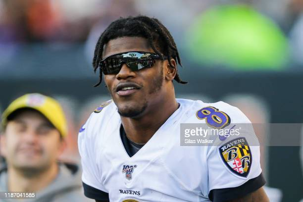 Lamar Jackson of the Baltimore Ravens stands on the sideline during the game against the Cincinnati Bengals at Paul Brown Stadium on November 10 2019...