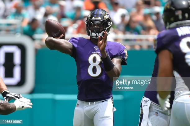 Lamar Jackson of the Baltimore Ravens throws a 33 yard touchdown pass to Willie Snead in the second quarter against the Miami Dolphins at Hard Rock...