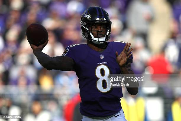 Lamar Jackson of the Baltimore Ravens throws a pass against the Los Angeles Chargers during the first quarter in the AFC Wild Card Playoff game at MT...