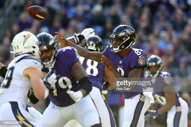 Lamar Jackson of the Baltimore Ravens throws a pass against the Los Angeles Chargers during the first quarter in the AFC Wild Card Playoff game at...
