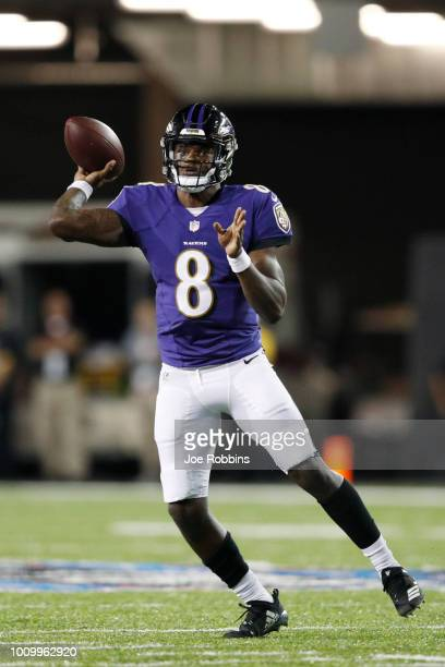 Lamar Jackson of the Baltimore Ravens throws a pass in the third quarter of the Hall of Fame Game against the Chicago Bears at Tom Benson Hall of...